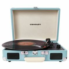 Briefcase-inspired portable three-speed turntable with built-in stereo speakers.  Product: TurntableConstruction Material: Wood and bonded leatherColor: TurquoiseFeatures:  3-Speed USB turntableRCA outputsStereo speakers Dimensions: 4.63 H x 14 W x 10.5 D