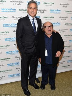 That's not Amal! George Clooneywas accompanied by funnyman Danny DeVito tothe SeriousFun...
