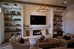 Fireplace with shiplap surround, wooden beams and open shelving