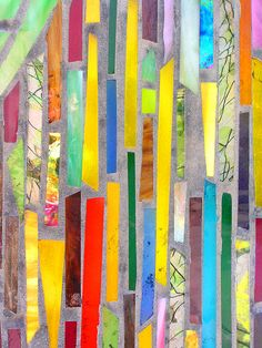 Glass mosaic - jutta schnecke. These are colored glass stripes concreted into a wall of a shop's entrance
