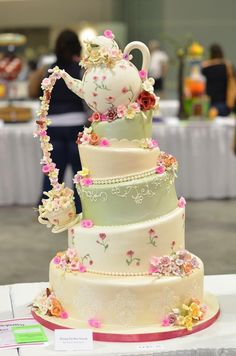 Lovely tea pot floral Alice in wonderland type wedding cake