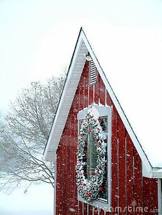 .Christmas snow covered red building with wreath - so chilly warm