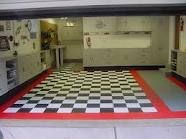 """Hey guys I am looking for a """"dream garage"""" type picture with bikes or empty (no cars). You know the type, fancy memorabilia and checkered floors. Garage Floor Tiles, Tile Floor, Garage Flooring, Garage House, Dream Garage, Garage Workshop, Workshop Ideas, Checkered Floors, Garage Renovation"""