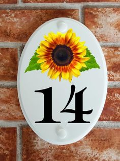 A range of pottery style house plaques feature prints of original artwork from our own sign artists. Hand cast in cultured marble these number plates are weatherproof outdoors. House Plaques, House Number Plaque, House Numbers, Floral Motif, Original Artwork, Mosaic, Decorative Plates, Pottery, Home Decor