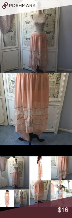 "Lush Up High Down Low Lace skirt Sz juniors L Lush Up High Down Low Lace skirt Sz juniors L.  Feminine and romantic beige peach skirt.  Side Zip. Lined to upper thigh then sheer there down.  Waist measures 29"". Hips measures approx. 36"".  Length Measures 26"" long in front and 40"" long in back.Shell 100% polyester, contrast 100% nylon. Lining 100% polyester.  #lisamariesvibe #bundlediscounts #lush #feminine #lifrty #boho #girly #romantic #daydate #dayshopping #daywithfriends #datenight Lush…"