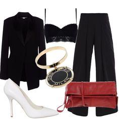 Outfit total black, per una serata importante : giacca nera in crêpe, monopetto, collo con revers in raso, abbinata a pantalone nero, vita alta, di linea ampia. Reggiseno nero in pizzo da indossare a vista sotto la giacca. Décolleté in pelle bianca tacco a spillo, clutch in pelle rossa. Bracciale in fantasia bicolore.
