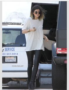 Kylie Jenner street style - overused white tee, black leather pants, & black boots