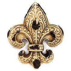 "C'est trés magnifique! Brown & Antique White Fleur-De-Lis Wall Plaque is perfect for accenting your walls, whether at home or at work. Hang this small distressed resin fleur-de-lis in your living room, office, bedroom, bathroom, kitchen, and more to add an instant touch of French flair.    	     	Dimensions:    	  		Length: 4""  	  		Width: 3 1/8""  	  		Thickness: 1/4""      	     	Hanging Hardware: 1 Small Triangle Hook"