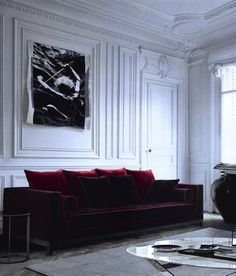 Maxalto red velvet sofa against vintage wall panelling