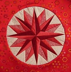 The Mariner's Compass will be coming soon to Nancy's Notions.  I love this design because I have perfect points every time.  When I first began quilting I tried to make one of these.  I finally gave up and developed a proceedure for assembly in the hoop.uploaded by user