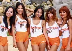 Hooters Employees around the world wear the same iconic uniform. Pictured are Hooter servers in Phucket, Thailand.