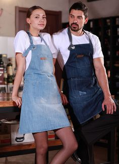 Blue, Light Blue or Light Gray Denim Bib Apron.  Denim Bib Apron for Bartenders, Baristas, Chefs. Perfect to use in the comfort of your own home kitchen. The best denim apron for cooking, gardening or crafting.  This apron is crafted from washed mid-weight denim and features a soft neck strap, and many pockets for storing work essentials. FEATURES: -Made of the highest quality 100% cotton  -Hand distressed mid-weight denim  -Adjustable neck with grommet  -Utility chest pocket  -Convenient…