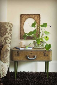 This is adorable, and a great place to store seasonal things. Imagine those legs a nice nutmeg color.     http://www.vintageandflea.com/storage/images/repurposed-roundup_suitcase-sidetable.jpg