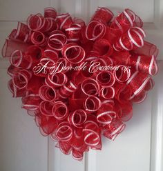 This Heart Shaped Wreath is so A-DOOR-ABLE!!! Made with deluxe metallic red & white deco mesh and solid red deco mesh. Measures approx. 21X 23 Very durable mesh to weather. ***OTHER COLORS AVAILABLE IN THIS BEAUTIFUL HEART WREATH*** CLICK ON LINK BELOW FOR GREAT GIFT IDEAS! ***Made in a smoke-free home*** ***SHIPPING: 1-3 Business days from order date. USPS. I do ship and wire in all my wreaths. The boxes are perfect for storing your wreath in when you are not displaying it. SOME FEED...