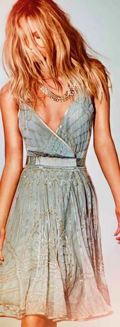 Lovely colour on a semi-casual dress. Not a fan of the cut on top but the skirt would be beautiful on its own!