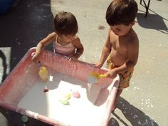 Good old goop! (Or gak or oobleck...) just corn starch and water and hours of fun scooping and pouring and squeezing.