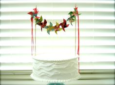 Kaleidoscope Sangria Pinwheel Cake Gourmet Bunting Garland Banner Vintage Photo Props Tutti Fruity (custom orders welcome). $35.00, via Etsy.