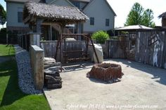 Custom Carved Firepit that looks like a tree trunk. The firepit area is on the lower patio and surrounded by reclaimed barn wood and accents to complete this back yard environment.