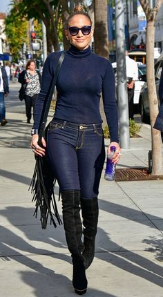 Jennifer Lopez in a navy turtleneck, jeans and thigh-high boots - click through for more celebrity-inspired winter outfit ideas