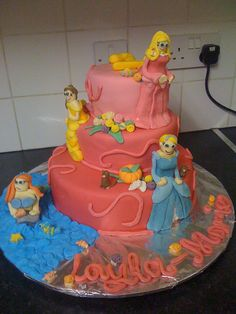 Disney Princess Cake! Cute idea but I would get it professionally done... or buy toy replicas)
