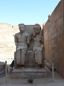 Statue of Tutankhamun and Ankhesenamun at Luxor, hacked at during the damnatio memoriae campaign against the Amarna line of Thutmoside pharaohs.