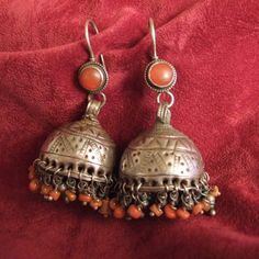 "Earrings ~ Afghanistan |  Silver, cornelians and coral grelots have the typical design of small domes which mean if you translate the word ""gushwar-e-kafasi""  birdcages."