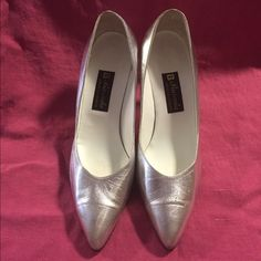 Silver Heels. Cute silver heels. Gently worn. Let me know if you have any questions.  Thanks for looking.  Barada Shoes Heels