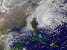 This NOAA satellite image taken Sunday, Oct. 2012 shows Hurricane Sandy off the Mid Atlantic coastline moving toward the north with maximum sustained winds of 75 mph. Tens of thousands of people w Cuba, Storm Surge, Hurricane Sandy, Atheism, Atlantic Ocean, East Coast, Climate Change, Sky, Naturaleza