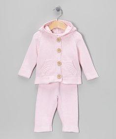 Both smart and stylish, this knit cardigan and pants combo is made from thick cotton and features a ribbed design, big buttons and oodles of plush comfort. The hood also makes sure to keep little noggins warm!Includes cardigan and pantsCottonMachine wash; dry flatImported