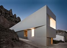"dezeen: ""This bright white wedge-shaped house thrusts out from the rock face behind it in the valley town of Ayora, near Valencia » """