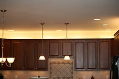 Remodeling Kitchen Lighting Trying to come up with ideas for how to decorate above the cabinets. Lighting only - Our company president added over cabinet lighting to his new home using microfluorescent light fixtures. An easy project.