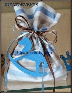 Μπομπονιέρα πολυτελείας πουγκάκι αλογάκι σε καφέ σιέλ συνδυασμούς.  Luxurious Christening favor theme little horse in light blue and brown combinations.   Code: MB0095 Ideatoevents.com