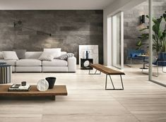 salon moderne avec carrelage de sol aspect bois ) grand format et carrelage mural gris aspect pierre