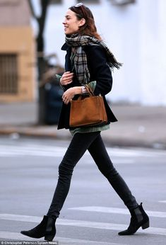 Here she comes: Alexa sports skinny jeans and trendy Chelsea boots as she marches across the street on Friday