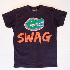 Florida Gators College Team Swag Black on Mercari Florida Gators College, College T Shirts, Cool Items, Swag, Sleeves, Mens Tops, Cotton, How To Wear, Stuff To Buy