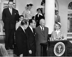 A Rose Garden Ceremony Honoring Dr. Jonas Salk (front row, 2nd from left), April 22, 1955. Front row, from left, Basil O'Connor, President, National Foundation for Infantile Paralysis; Salk; President Dwight D. Eisenhower; Oveta Culp Hobby, Secretary of Health, Education and Welfare
