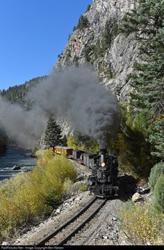 D&RGW #473 leads it's mixed train south along the Animas River at the Cement Wall. This section of track is wedged between a 800 foot tall piece of granite and the rough waters of the Animas River making it a scenic highlight of the Silverton Branch.