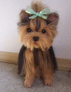 """a 8"""" yorkie needle felted out of mohair, wool, and alpaca fibers"""