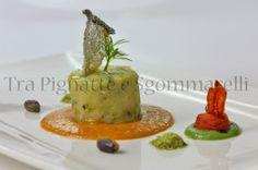 Mantecato di baccalà cotto a bassa temperatura, con patate e pistacchi, accompagnato da emulsione di pomodoro e di agretti