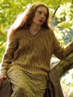 This v neck jumper jumper has an unusual scrolling cable detail and has been designed by Marie Wallin using Kid Classic.