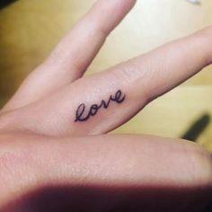 'Love' finger tattoo via Erika