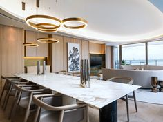 Maybe an altenative chandelier, if the big one does not work out?  YABU PUSHELBERG - RESIDENCES HENGE - light rings horizontal
