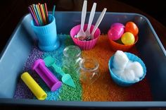 Kids willenjoy hours of sensory playwith a rainbow rice bin! Grab the recipe for my rainbow rice, and let's puttogether a coloured rice sensory bin for your kids! To make our rainbow rice activity bin: After dyeing our rice, and letting it dry, I spread the rice out in rainbow fashion in a plastic bin,and added colourful bowls, plastic eggs, , scoops, glass jars, craft sticks, glass beads and cotton balls. What kind of container makes a good sensor
