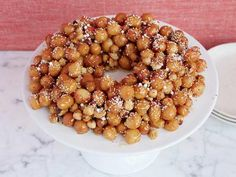 Struffoli Love this my Nana used to make this every Christmas - sometimes as wreaths, sometimes she would mound it into a Christmas tree! so good