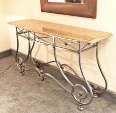 Console table in brushed iron with brass inserts and a french red marble top
