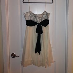 BCBG short party dress Beautiful white chiffon BCBG dress with black sash (attached) and gorgeous black floral embroidery with sequins and beading. BCBGMaxAzria Dresses Prom