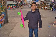 Pink Penny skateboard w/ green wheels.    Summer skate.