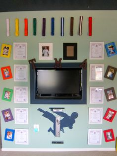 Tae-Kwon-Do Wall.  I needed a place to display my son's belts.  So, I bought some cheap frames and painted them the colors of the corresponding belt.  We cut a hole in the wall and mounted a flat screen and covered it with moulding.  We also did this with his Wii, DVD player, and DVR.
