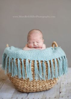 Mary Beth Miller Photography sweet newborn baby in a basket http://marybethmillerphotography.com/