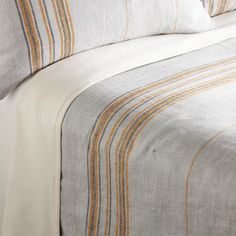 RUSTIC STRIPED LINEN BLANKET--Slubbed French and Belgian linen with yarn-dyed stripes adds luxurious texture and comfort to your bed. Backed with cotton flannel. Machine wash. Imported.